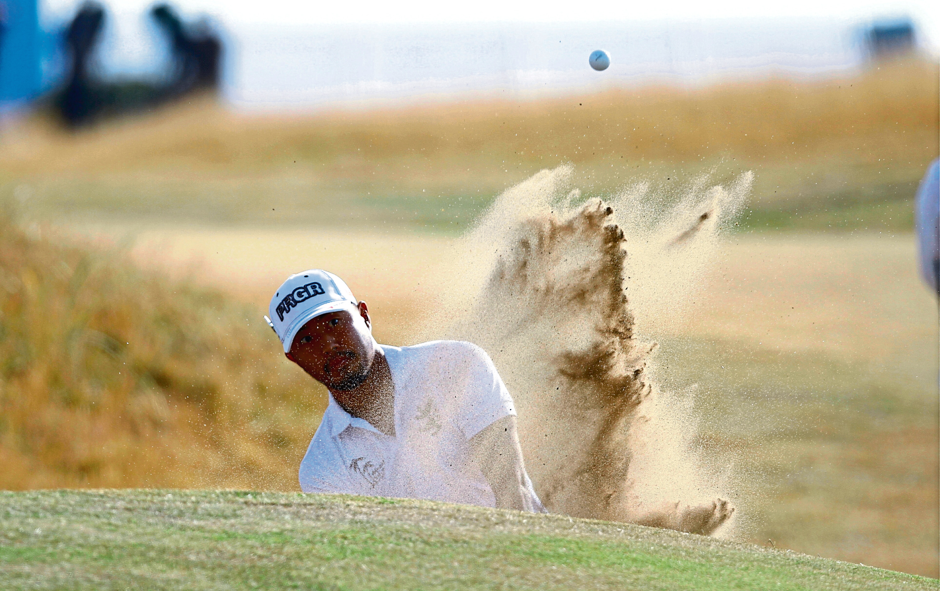 Courier News/Sport - Steve Scott story - Open Golf.  CR000 Picture shows; Satoshi Kodaira from Japan, blasts out of a bunker of the first, at the first round of The Open Golf Championship at Carnoustie today. Thursday 19th July 2018