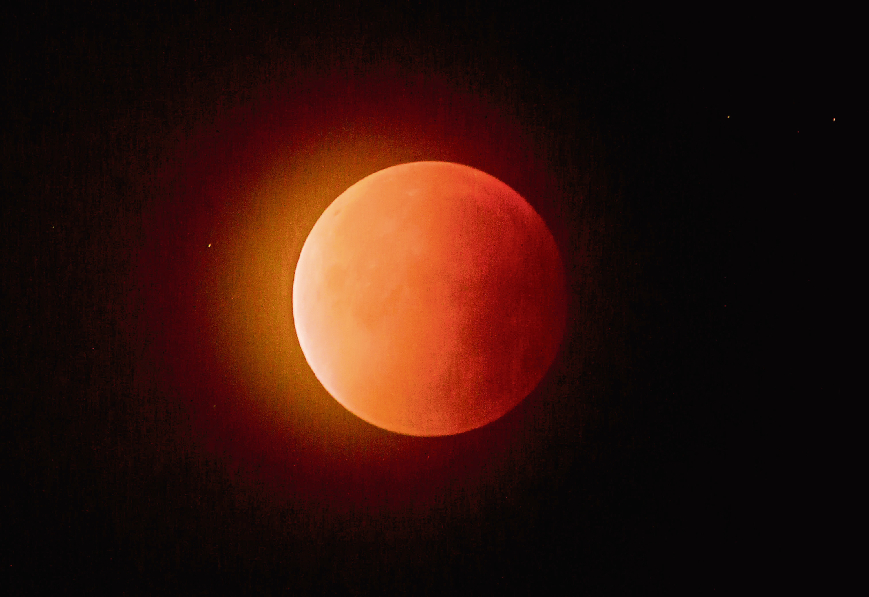 """A blood red """"supermoon"""" in the skies above Falkirk, created from a lunar eclipse with the moon near to its closest point to the Earth."""