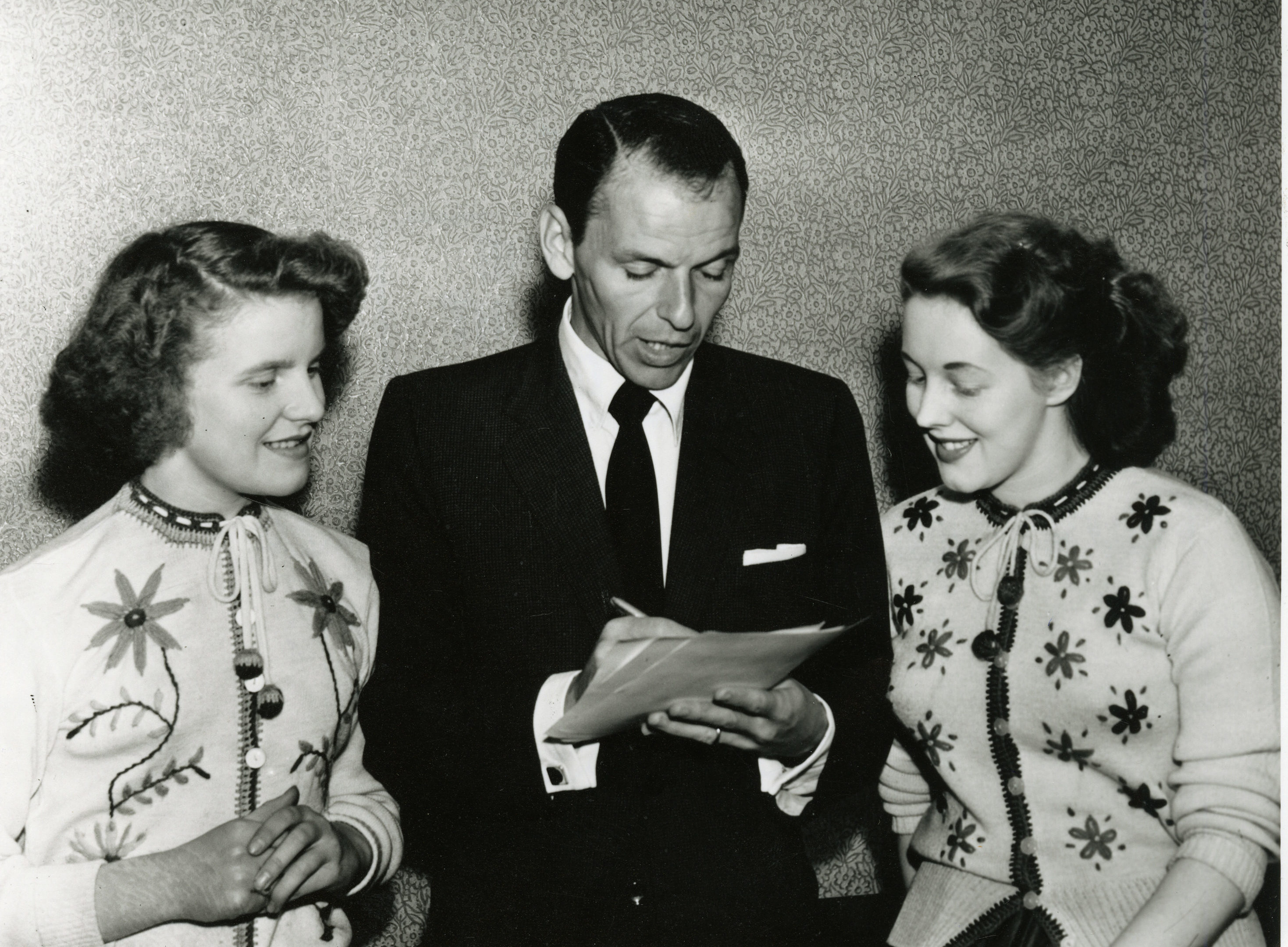 Frank Sinatra signing autographs after his Caird Hall concert.