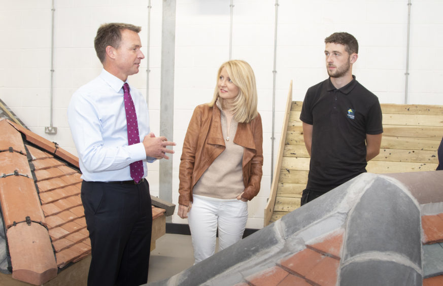 DWP Secretary Esther McVey at Brechin Campus with John Forster, owner and chairman, and roofer Jack Davey.