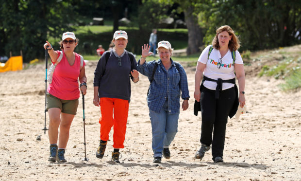 Charity campaigner Sarah Brown (right) with Great British Bake Off presenter Sandi Toksvig (second right), her wife Debbie Toksvig (second left) and actress Arabella Weir at Aberdour beach, as they continue along the 117-mile Fife Coastal Path.