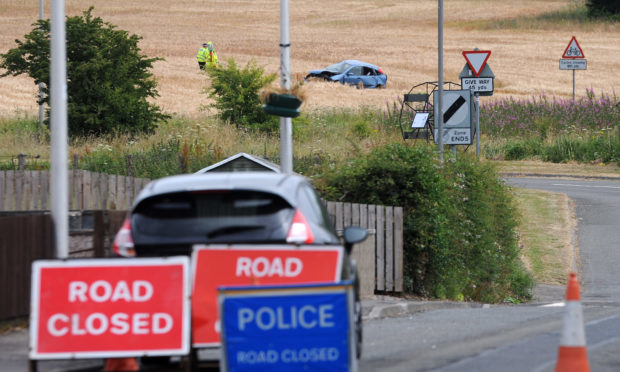 Police investigate following the crash on the A911.