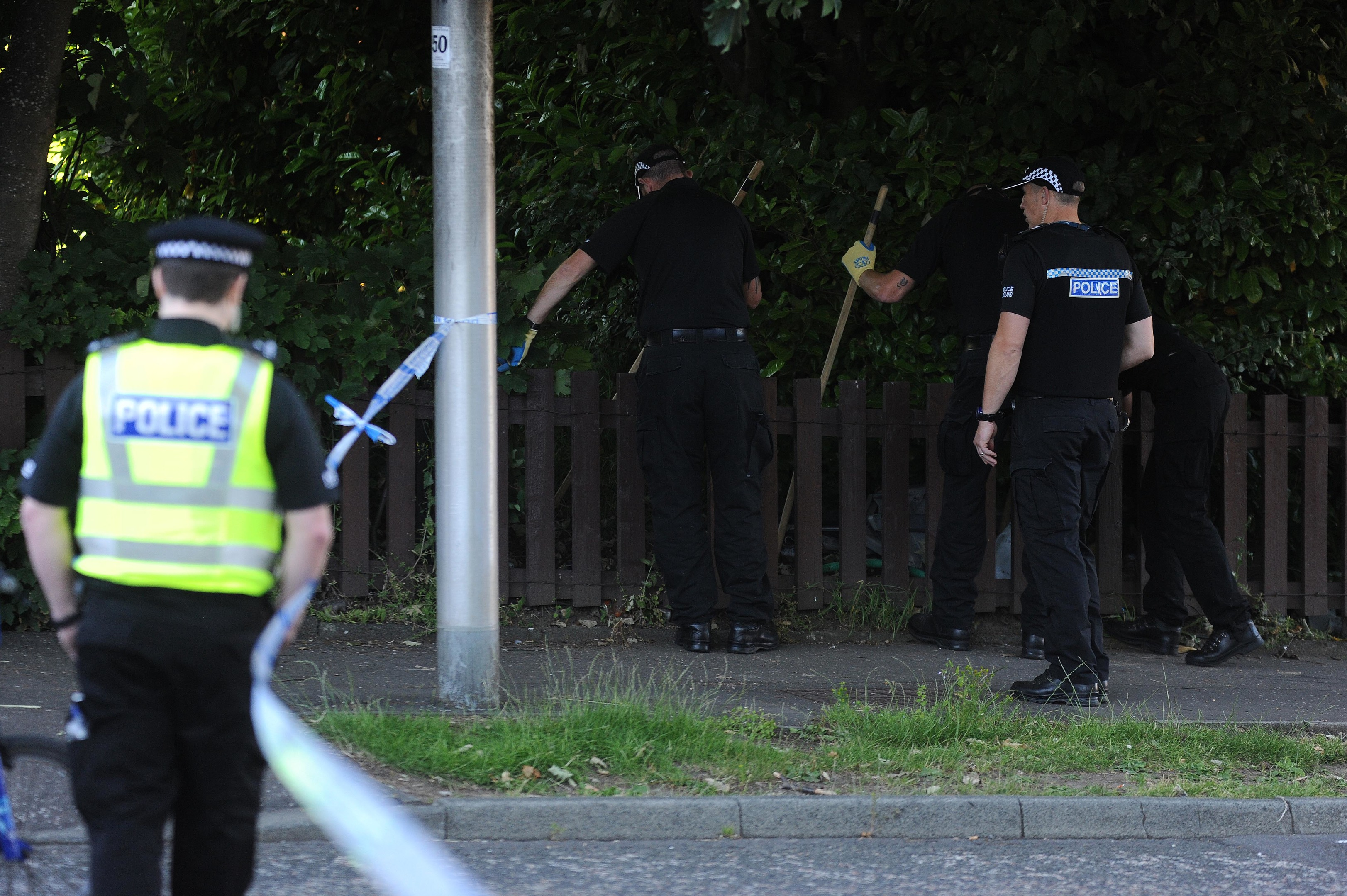 The police search team in Kirkcaldy's Valley Gardens following the alleged incident.