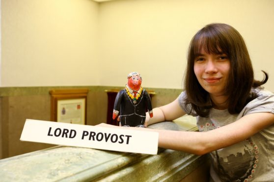 Chloe Townsend, 16, in the City Chambers with her Lord Provost Penguin, that she made for Lord Provost Ian Borthwick.