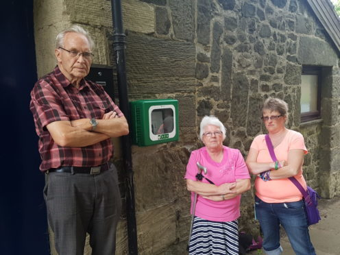 Chairman Ron Page and community council members Mary and Denise Wallace are appealing for help in tracing the stolen device.