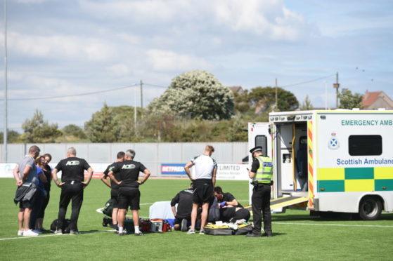 Jordan Brown receives treatment.