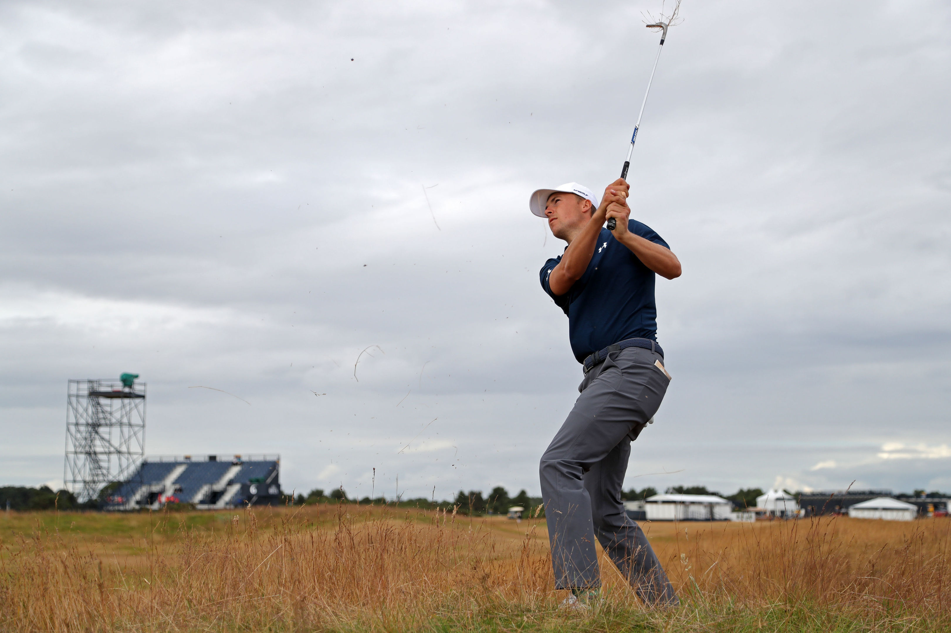 Freshly shorn Jordan Spieth chips from the rough during day three.
