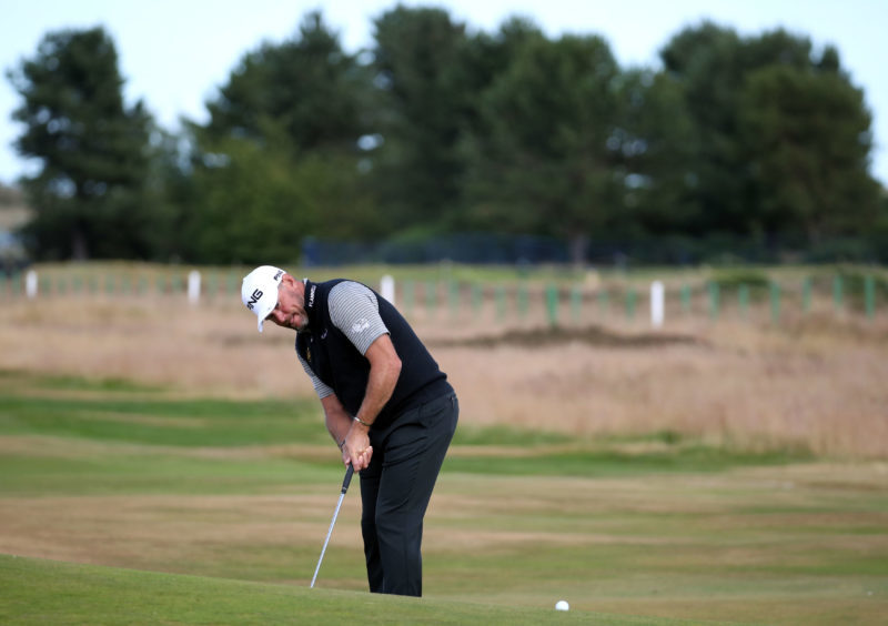 England's Lee Westwood putts on the 7th green during preview day three of The Open Championship 2018.
