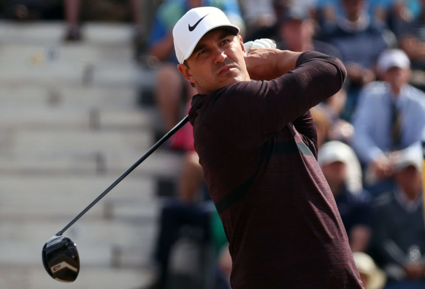 USA's Brooks Koepka tees off the 3rd during day one of The Open Championship 2018.