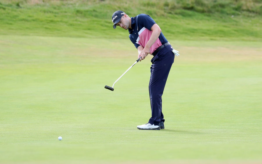 Scotland's Russell Knox putts on the 5th green.