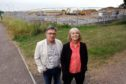 Local residents Kate Holy and Martin Dibbs at the site for the new housing in Station Road, Kingsbarns.