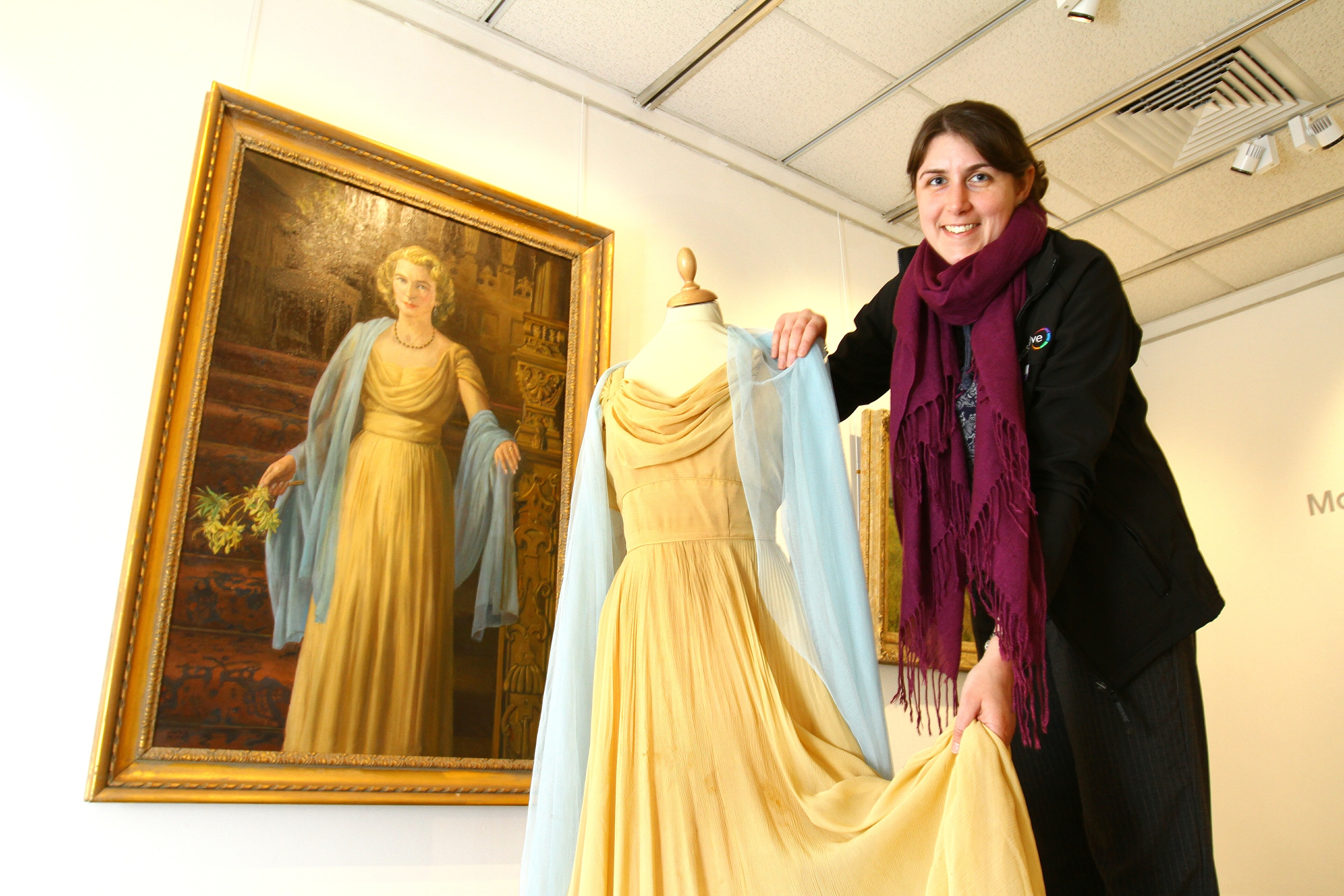 Visual arts officer Gill Ross with the portrait of Lady Sophie Lyell by artist James McIntosh Patrick, which is on show at the Meffan in Forfar, along with the dress worn in the painting.
