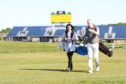 Head pro Colin Sinclair out on Carnoustie Golf Links with a novice player.