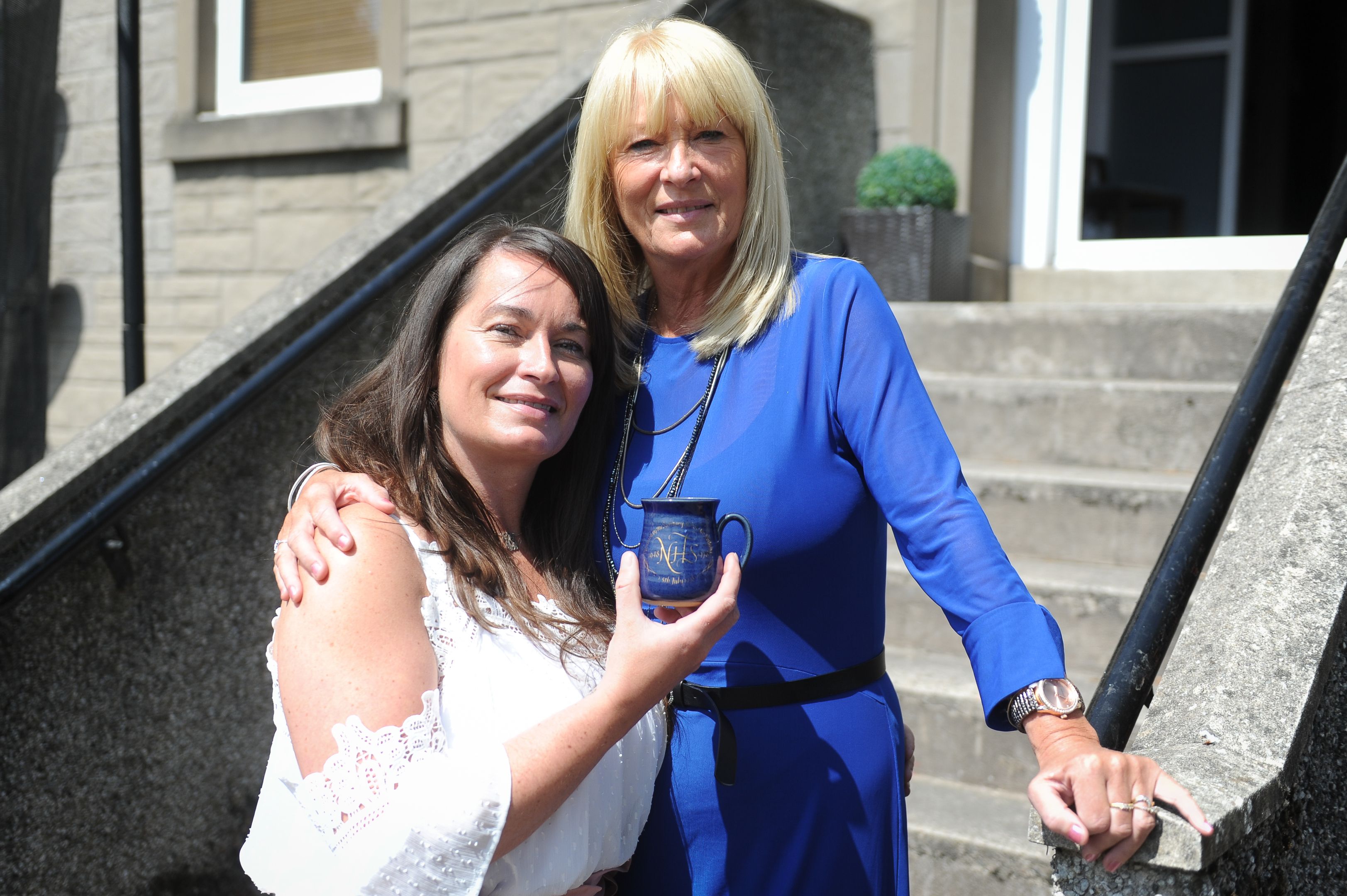 Abbie Irons and Louise Myers with the commemorative mug.