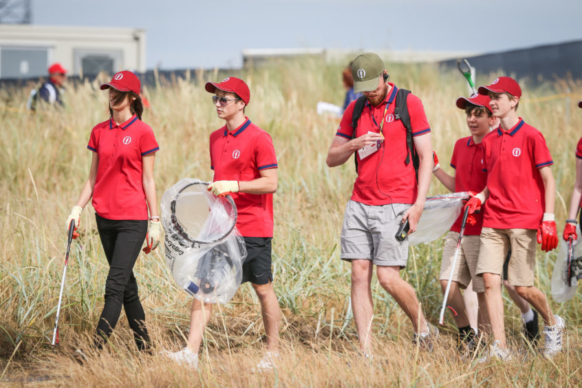 The army of volunteers (litter pickers) at the Open on Monday. Picture: Kris Miller.