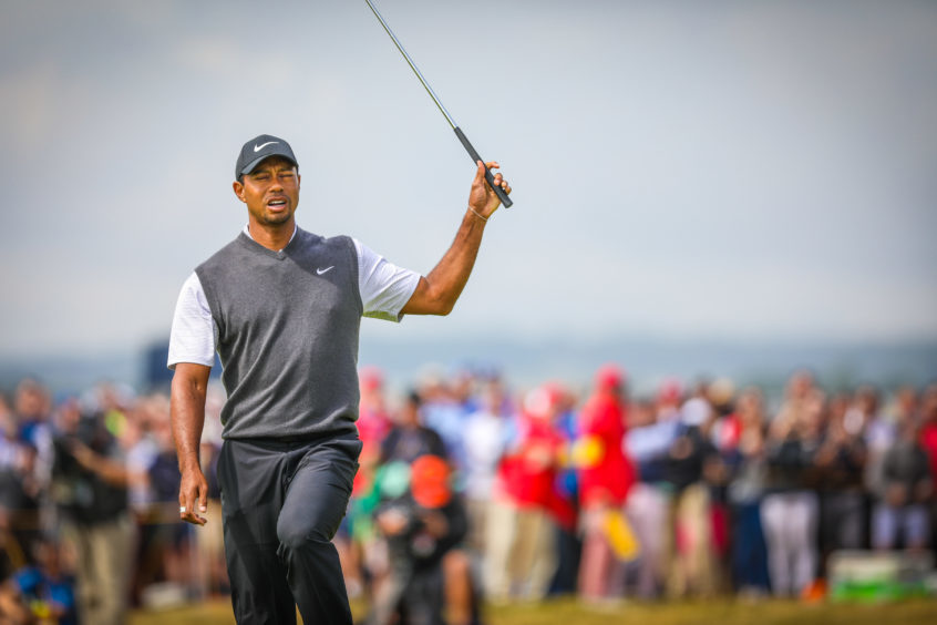 Tiger Woods reacting after missing a putt