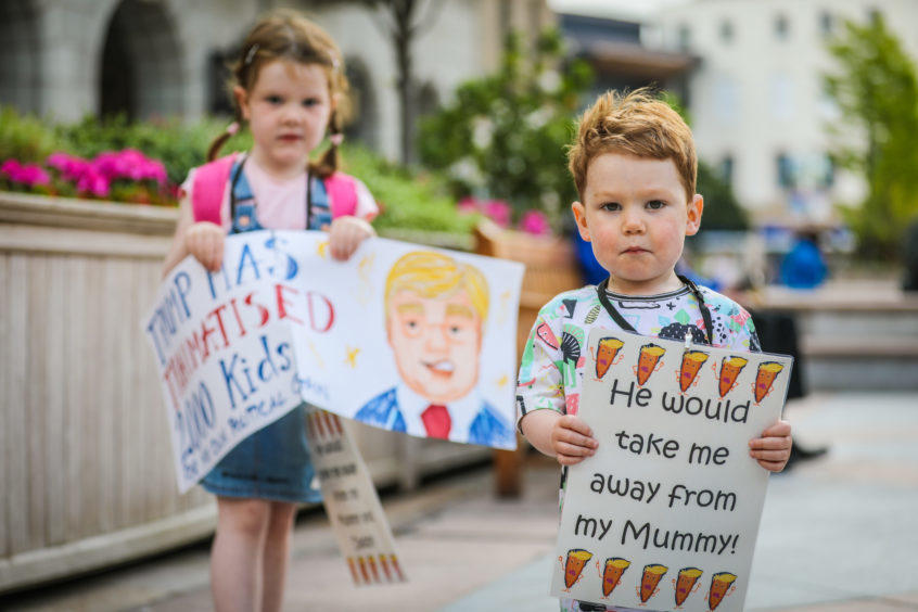 Oscar (2) and Lucy Galloway (4) were holding banners.