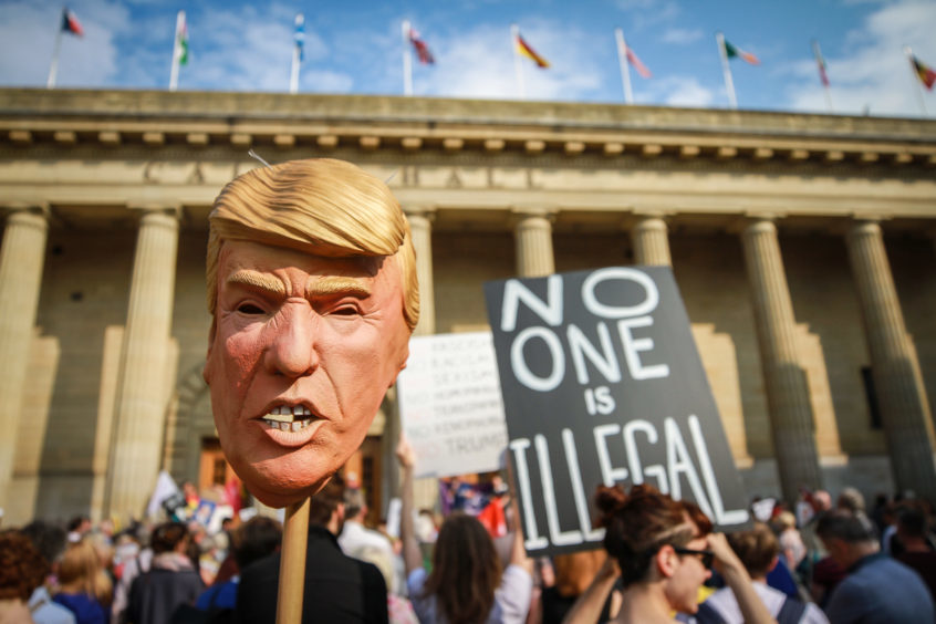 Hundreds of people gathered in City Square, Dundee, to protest President Donald Trump visit to the UK.  Pictures: Kris Miller.