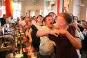 Fans celebrating a Croatia goal in Post Office Bar, Dundee.