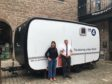 Producer Victoria McArthur with operator Mark Thompson in front of the Listening Project trailer.