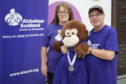 Reg and Angie with the toy monkey raffle prize