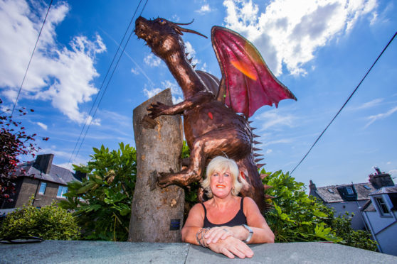 Fiona Philp with the dragon in the background.