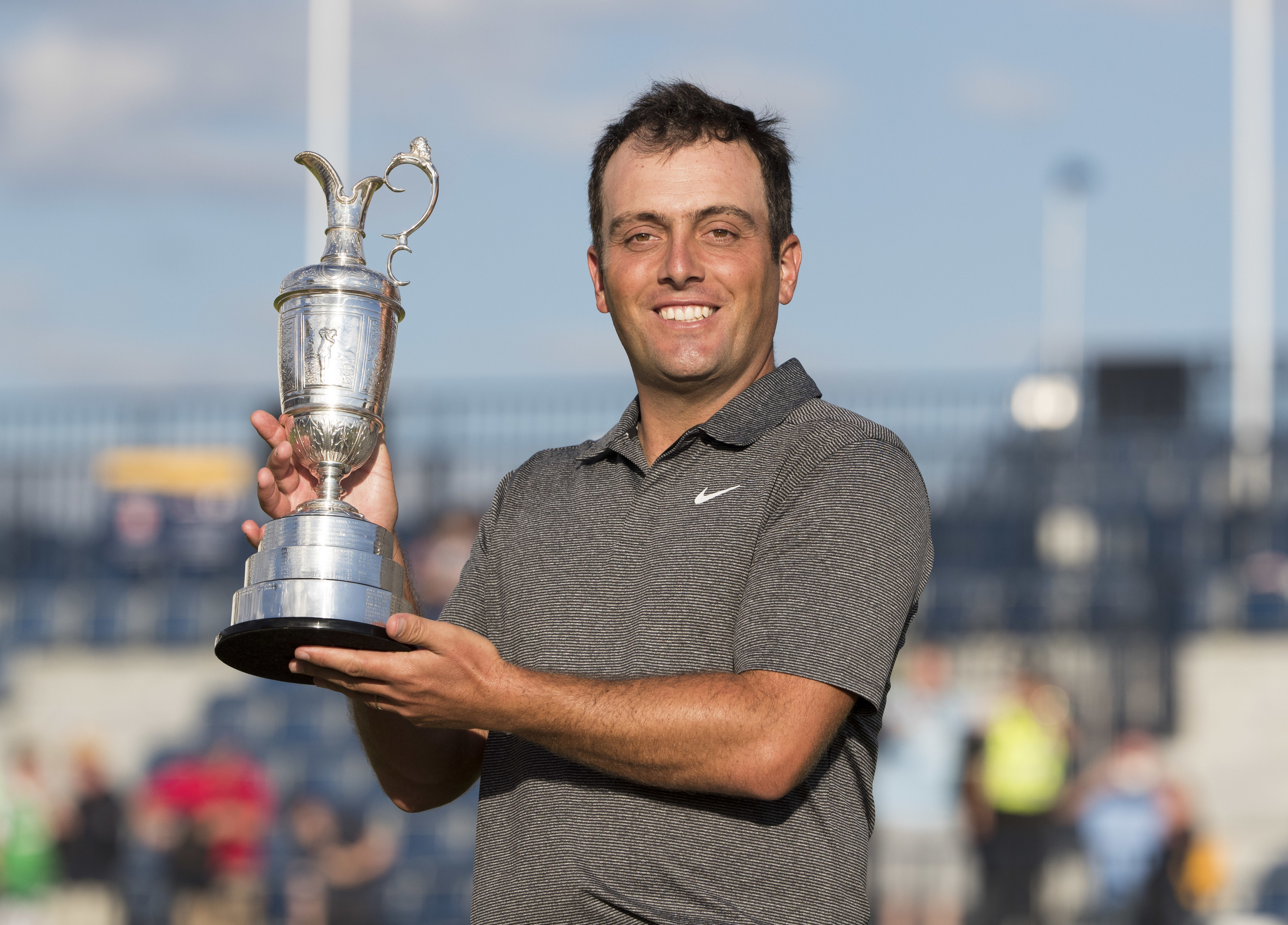 Italy's Francesco Molinari celebrates his win with the Claret Jug.