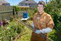 Trainee beekeeper Pauline Normand with some of the sticks that were poked at the bees.