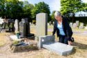 Courier News - Fife - Sarah Vesty - Graves Vandelism in at cemetary - CR0002372 - Inverkeithing - Picture Shows: Isobel Ward (67) from Inverkeithing is hurt & disgusted in what appears a targetted attach on the grave stone of her late husband and a memorial plaque in seperate section of cemetary - Thursday 5th July 2018