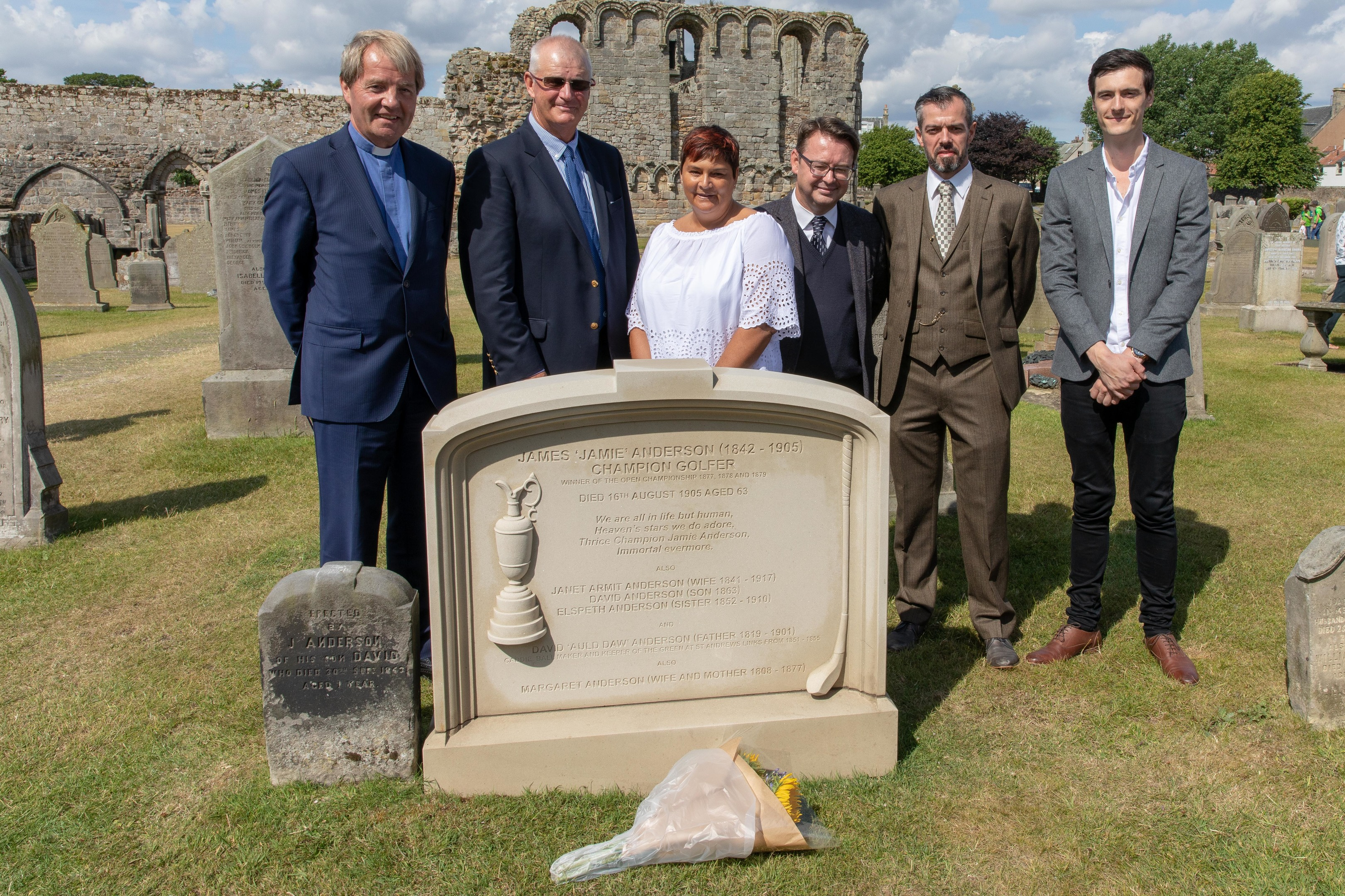 Rev Dr Russell Barr, Sandy Lyle, Sharon Allan (GGG Grandaughter), Roger McStravic, Mark Ritchie (Stonemason) and David Allan (Sharons son) at the new Headstone for Championship Golfer Jamie Anderson who was buried in a paupers grave