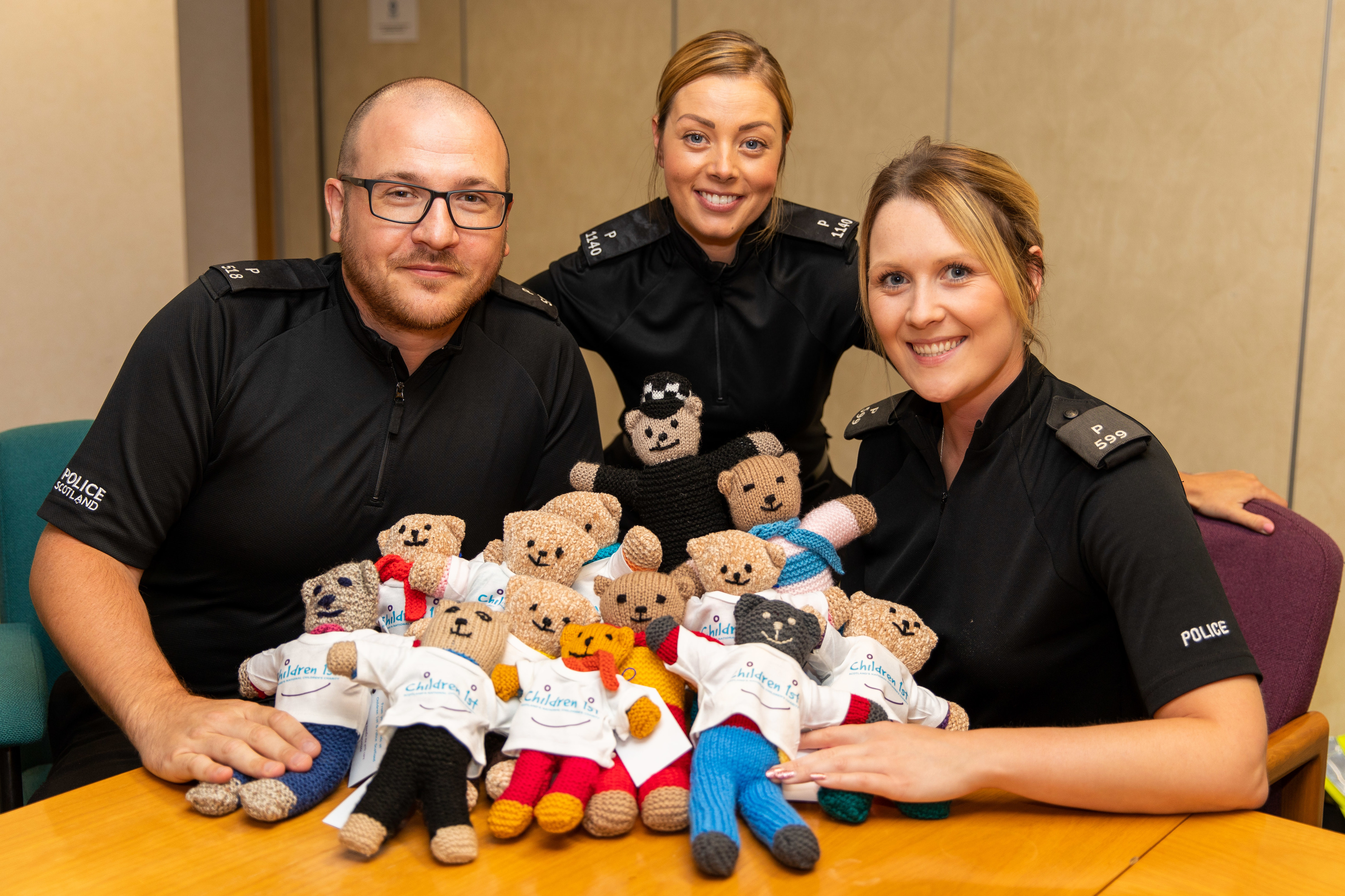 Officers Steven Piercy, Nicola Whitelaw and Brittany Primeau with the new Trauma Teddies