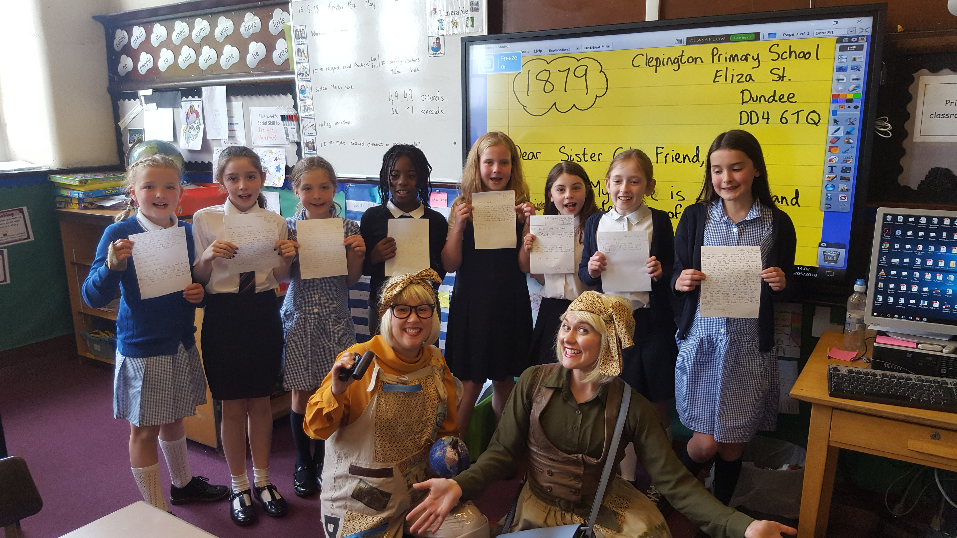 Dundee pupils with their pen pal letters.