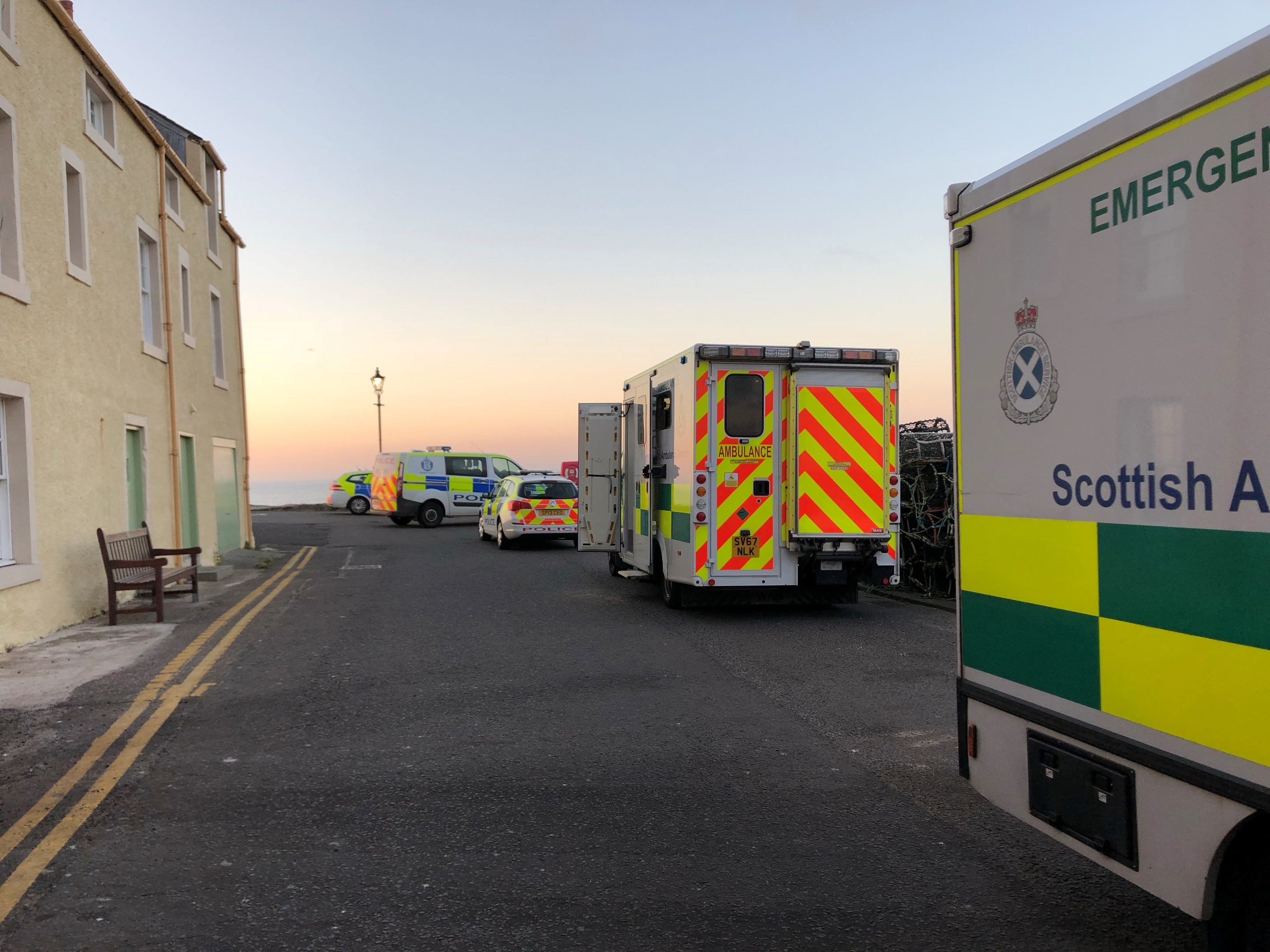 Police and ambulance at St Andrews pier.