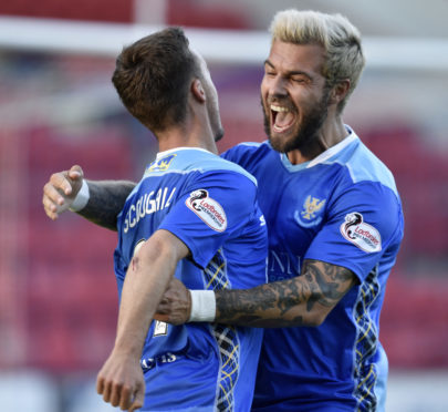 Richard Foster celebrates with Stefan Scougall.
