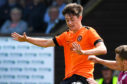 Dundee United's Declan Glass is tackled.