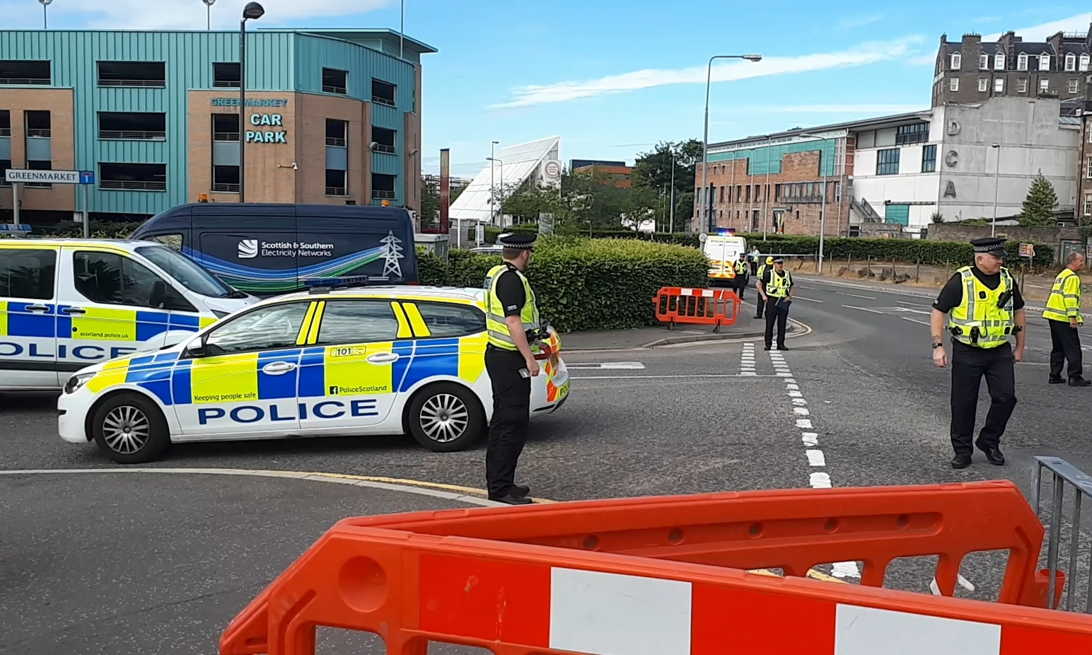 Police and electrical engineers at the scene.
