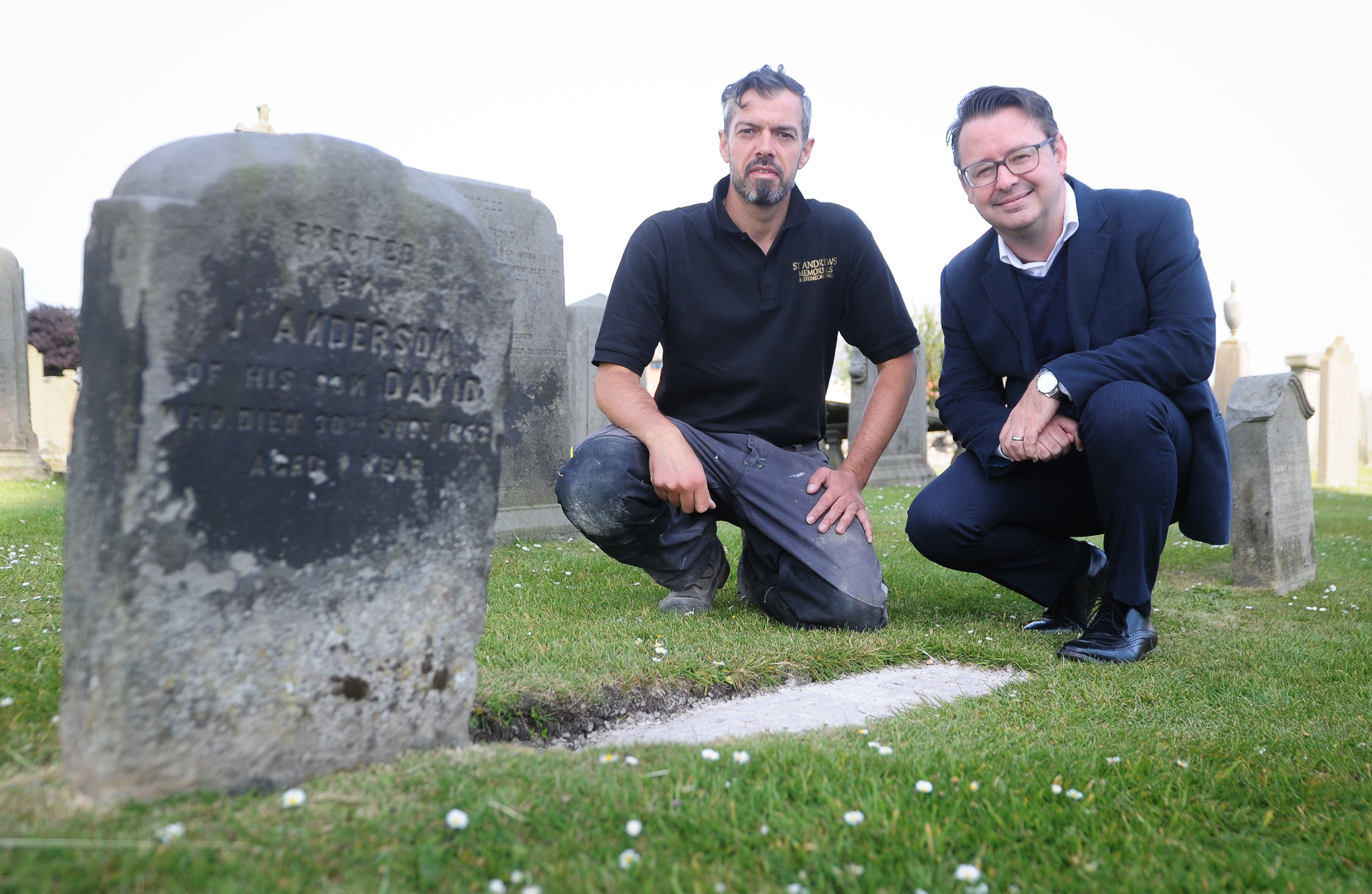 St Andrews stonemason Mark Ritchie (left) with golf historian Roger McStravick next to the gravestone in St Andrews Cathedral that was erected by Jamie Anderson for his infant son.