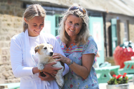 Picture shows; Annie and Kate Porter, with Scruffy the Jack Russell.