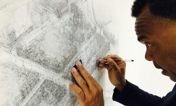 Carl Lavia working on his Perth drawing.