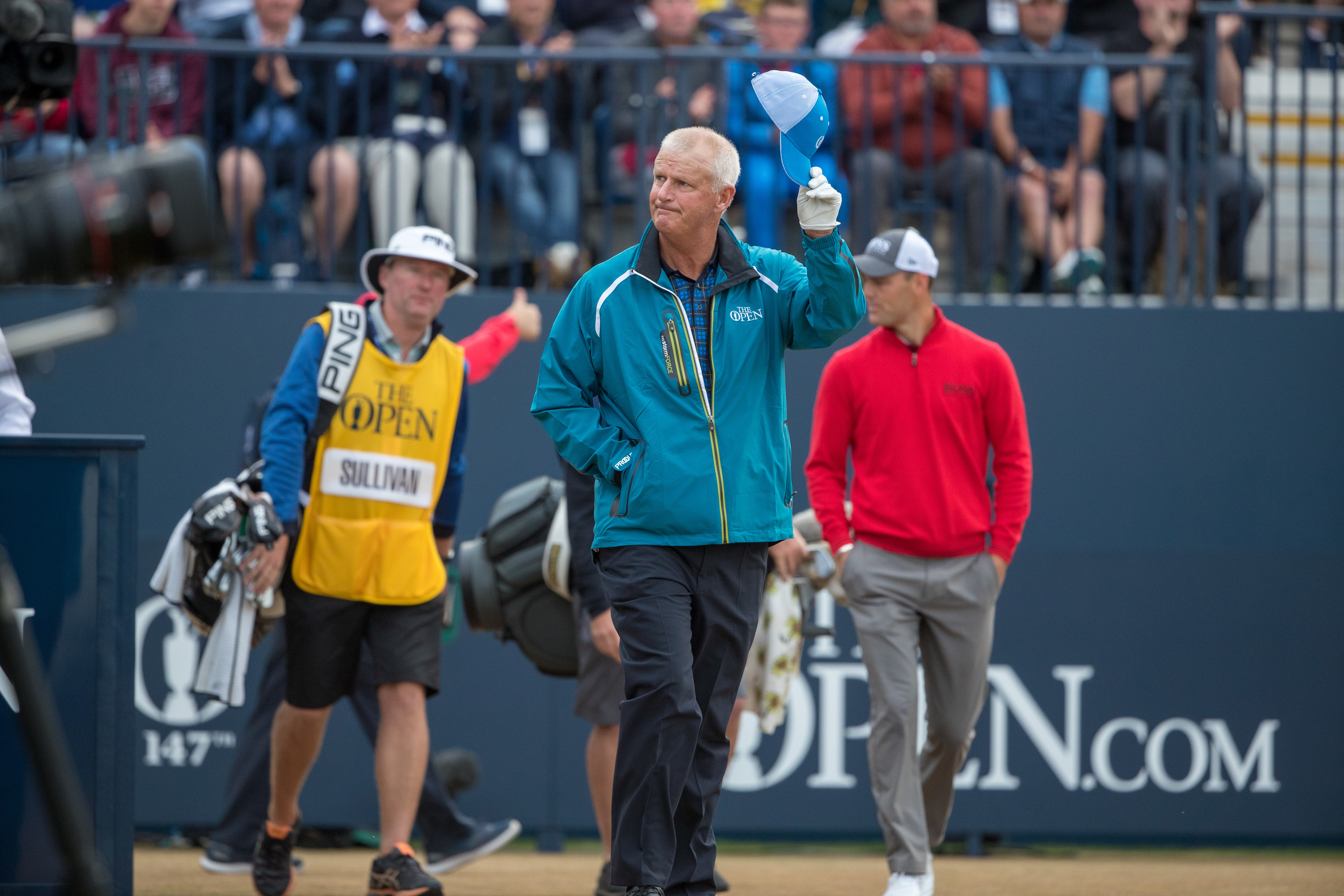 Sandy Lyle is welcomed on to the first tee.