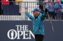 Sandy Lyle acknowledges the crowd on the 18th.
