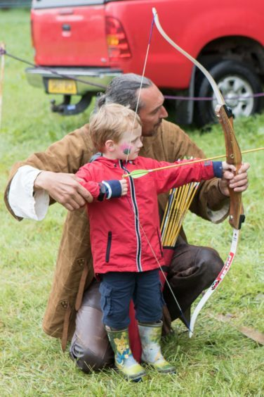 A youngster learns his way around a bow.