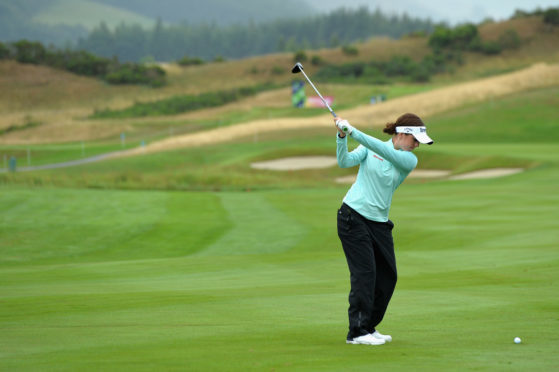 Back on the ball: New British Open champion Georgia Hall in practice for the European Team Championship at Gleneagles.