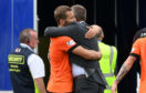Dundee United manager Csaba Laszlo embraces goalscorer Pavol Safranko at full-time.
