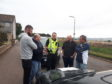 Police with members of the Howe of Fife rugby club