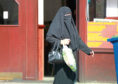 A Muslim woman wearing a Burka.