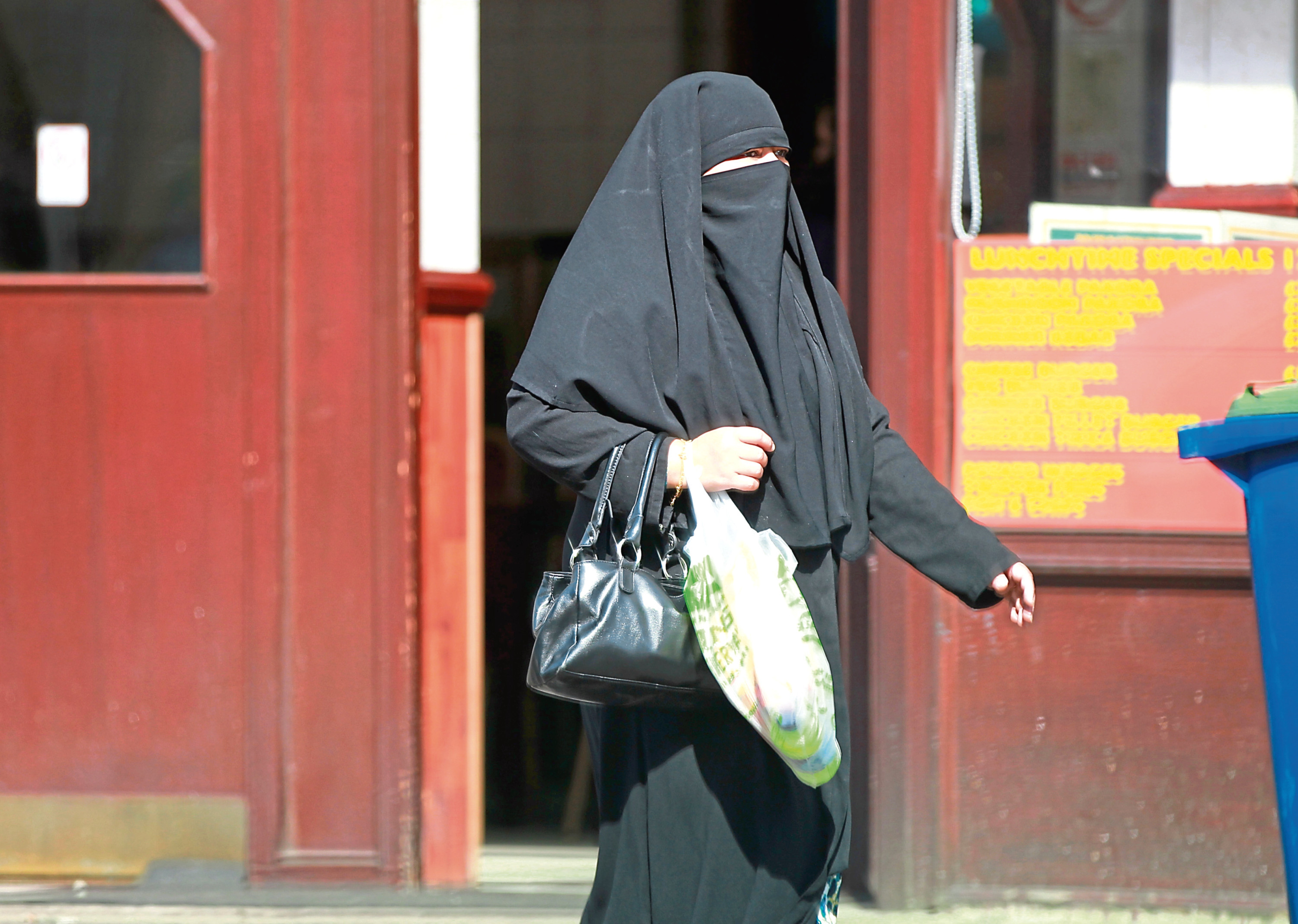 A Muslim woman wearing a Burka.
