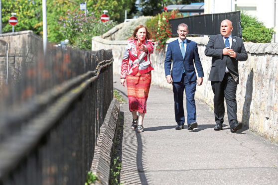 Jane Ann Liston (Convenor StARlink) Michael Matheson, Transport Secretary and Dita Stanis-Traken (Secretary for StARlink) on what used to be part of the old railway.