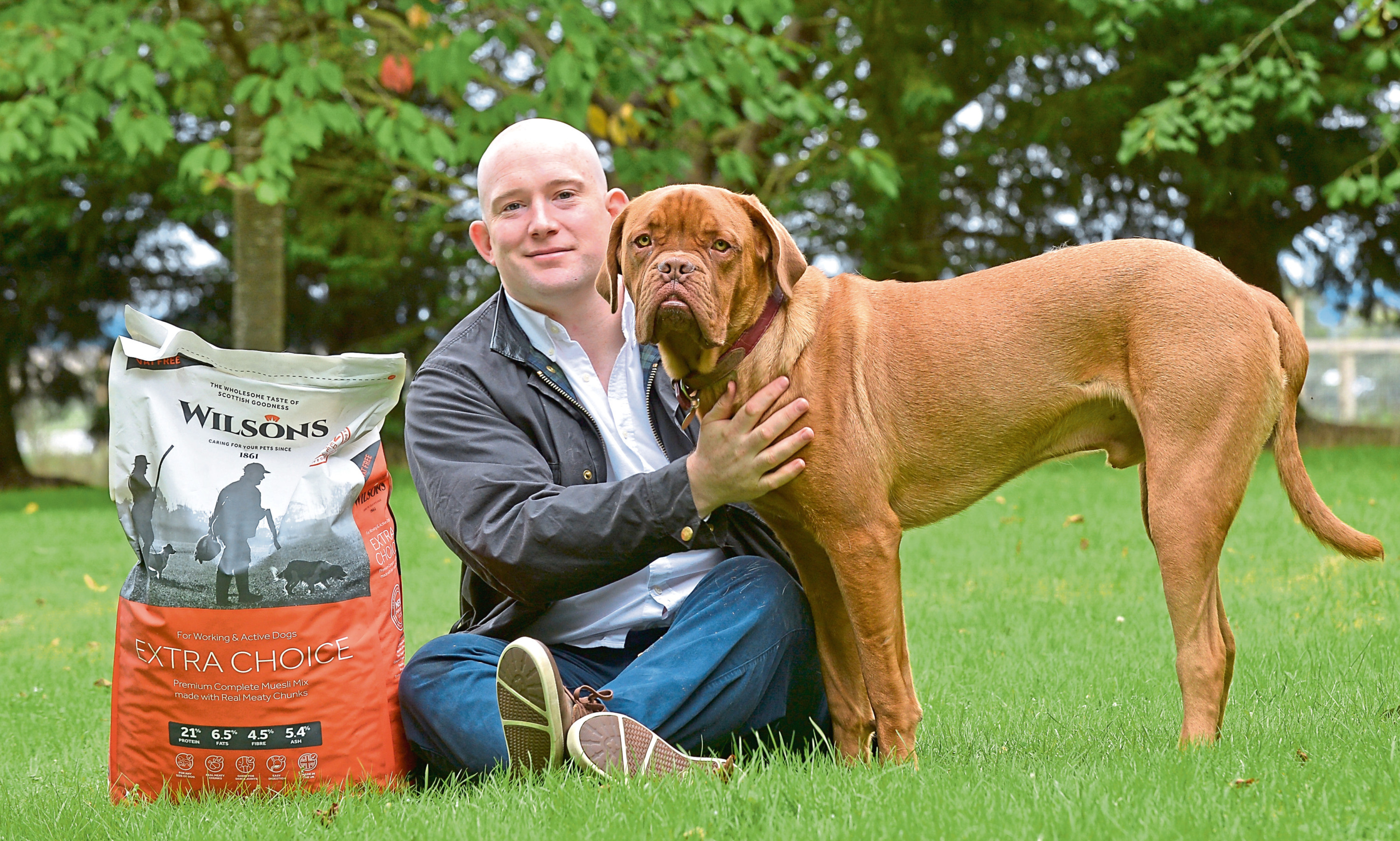 Craig Wallace of Wilsons Pet Food with puppy Bruce.
