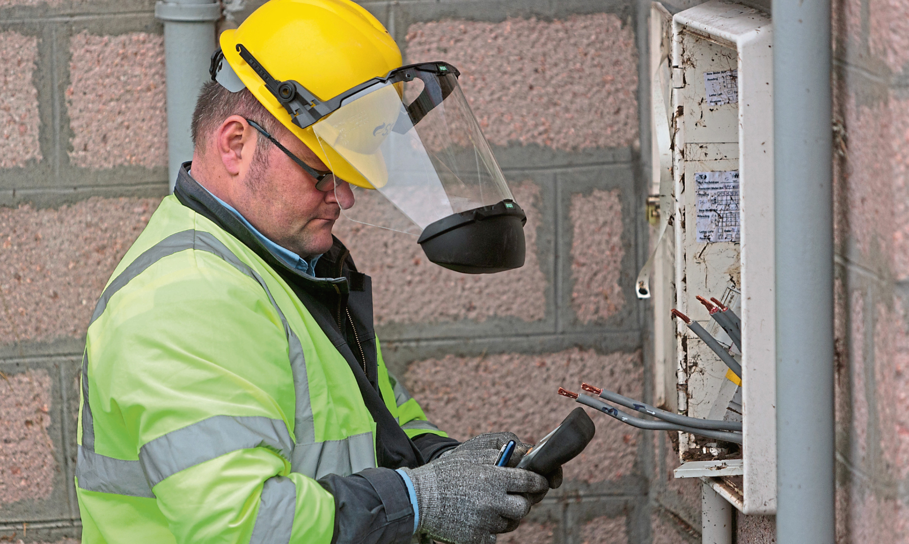 An SSE technician works on a household supply connection.